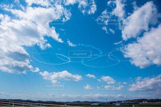 ブルーインパルスによる五輪の写真・画像素材[3033038]