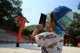写メ撮る子供の写真・画像素材[763499]