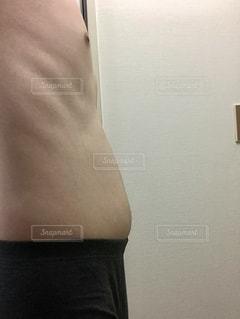 ダイエットとトレーニング途中の写真ですの写真・画像素材[1293670]