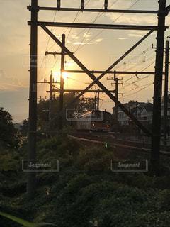 夕日と電車の写真・画像素材[763038]