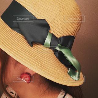 帽子をかぶっている人の写真・画像素材[775668]