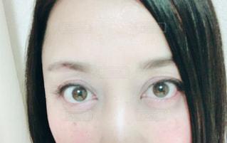 女性 目のアップの写真・画像素材[1128256]