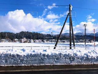田舎の雪景色の写真・画像素材[1090243]