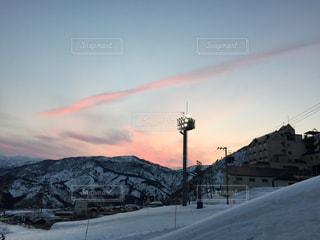 夕焼けのスキー場の写真・画像素材[785698]