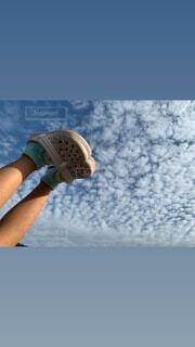 青い空の人の写真・画像素材[3798030]