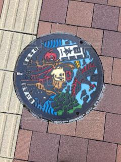 レンガの歩道上の標識の写真・画像素材[803026]