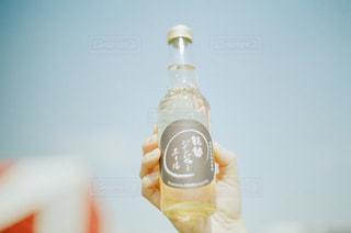 ボトルとオレンジ ジュースのガラスの写真・画像素材[1007791]