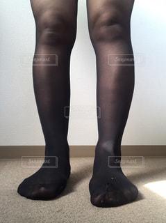 黒のドレスを着ている人の写真・画像素材[1550253]