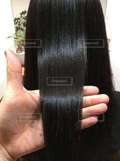 ツヤのある髪を持っている写真の写真・画像素材[903366]