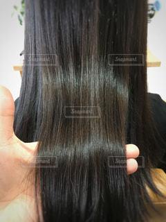 髪質改善された艶髪のアップ写真です。の写真・画像素材[910346]