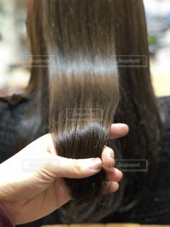 ツヤ髪をもつの写真・画像素材[968068]