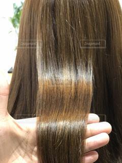 ツヤのある髪質改善後の髪の写真・画像素材[1523085]