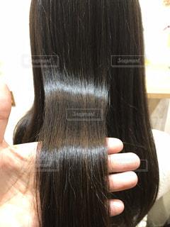 ツヤ髪のアップ写真です。の写真・画像素材[2180831]