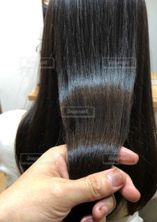 黒髪のロングのツヤ髪の写真・画像素材[2180834]