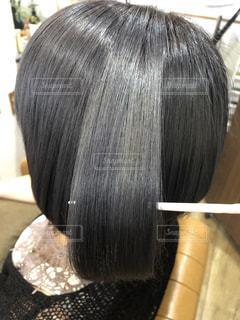 カラーヘアのツヤ髪の写真です。の写真・画像素材[2376818]