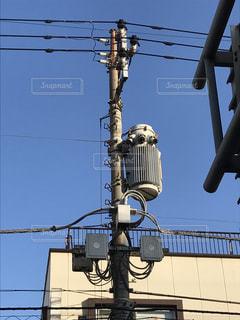 電柱の上の何かの写真・画像素材[829556]