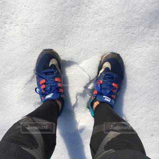 雪の日のランニングの写真・画像素材[991394]
