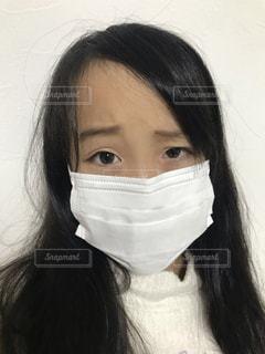 女マスク顔の写真・画像素材[2807561]