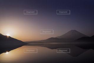 背景の夕日の写真・画像素材[1299666]