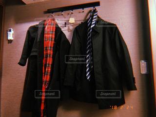 スーツとネクタイを身に着けている男の写真・画像素材[1025332]