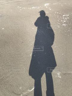 砂浜の人影の写真・画像素材[1035684]