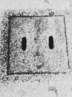 雪のアート四角いニコちゃんの写真・画像素材[888691]