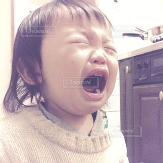 1歳児泣くの写真・画像素材[891520]