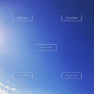 太陽から出る光の写真・画像素材[914231]