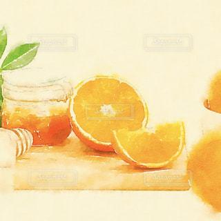 オレンジ ジュースのガラスの写真・画像素材[1599351]