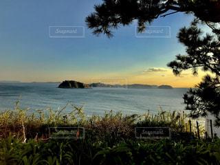 夕焼けと海の写真・画像素材[900457]
