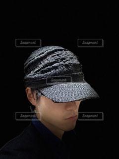 黒い帽子を被った男性の写真・画像素材[903855]