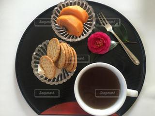 コーヒーのカップとプレートの写真・画像素材[1646393]