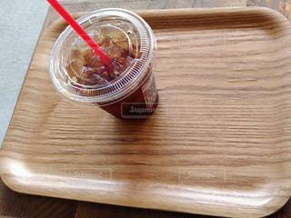 木製テーブルの上のコーヒーの写真・画像素材[1127960]