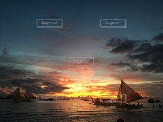 沈む夕日の写真・画像素材[934483]