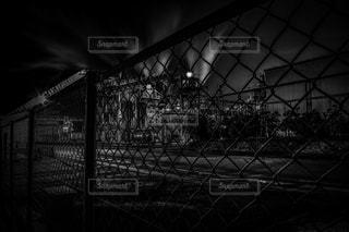 フェンス越しの写真・画像素材[936887]