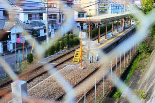 フェンス越しの写真・画像素材[953140]