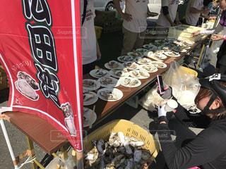 ツールド三陸での一コマ。蒸し牡蠣の写真・画像素材[954555]