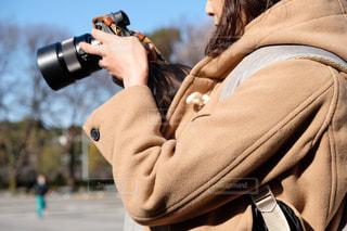 カメラを見る女性の写真・画像素材[1707389]