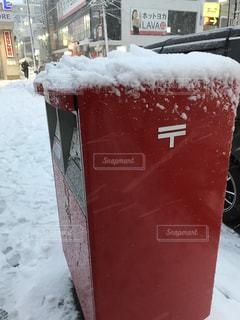 雪に覆われたポストの写真・画像素材[971920]