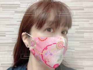 ピンクのちりめんマスクの写真・画像素材[3478446]