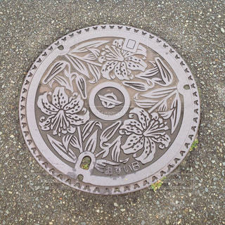 福岡県宗像市 マンホールの蓋の写真・画像素材[977099]