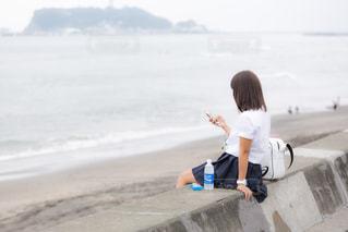 海の見える場所にいるJKの写真・画像素材[1209234]