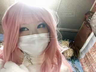 ピンク色のウイッグの写真・画像素材[1037238]