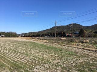 レールを運搬する貨物列車の写真・画像素材[1011237]