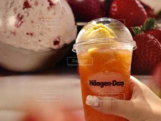 オレンジ ジュースのガラスの写真・画像素材[1406407]