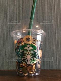 スタバの空きカップのボタン入れの写真・画像素材[1006015]