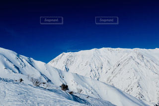 雪に覆われた山の写真・画像素材[1029757]