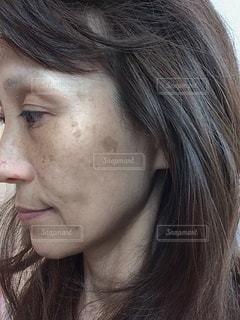 女性のクローズアップの写真・画像素材[3483000]