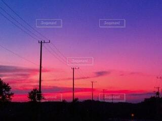 夕日を背景にした街並みの写真・画像素材[3658304]