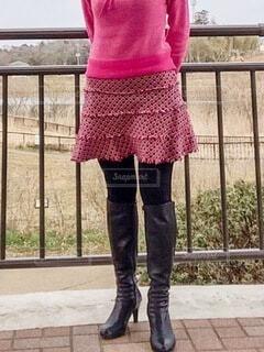 フェンスの前に立つ人の写真・画像素材[4200746]